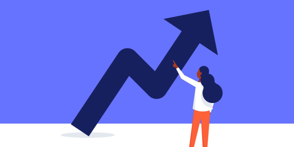 woman looking at startup growth arrow